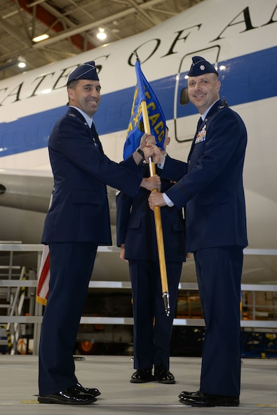 Col. Robert Billings, left, commander of the 595th Command and Control Group, passes the guidon to Lt. Col. Douglas Dodge, right, commander of the 595th Aircraft Maintenance Squadron (AMXS) at the group's activation Oct. 10, 2016. The 595th AMXS was awarded the Air Force Global Strike Command Unit Effectiveness Award Jan. 4, 2018, barely a year after the activation of the group.