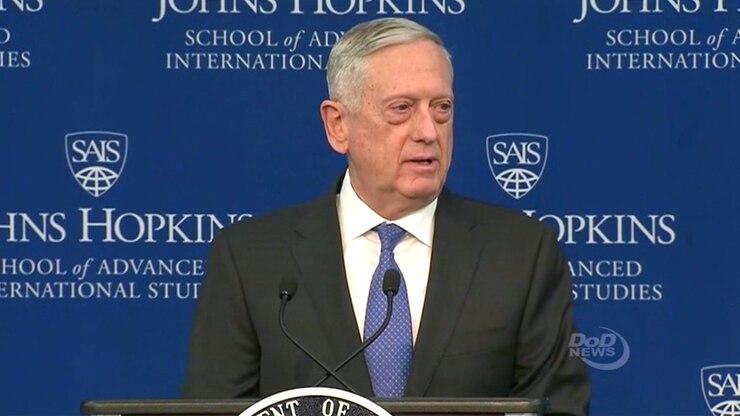 The Defense Secretary James N. Mattis speaks from behind a podium.