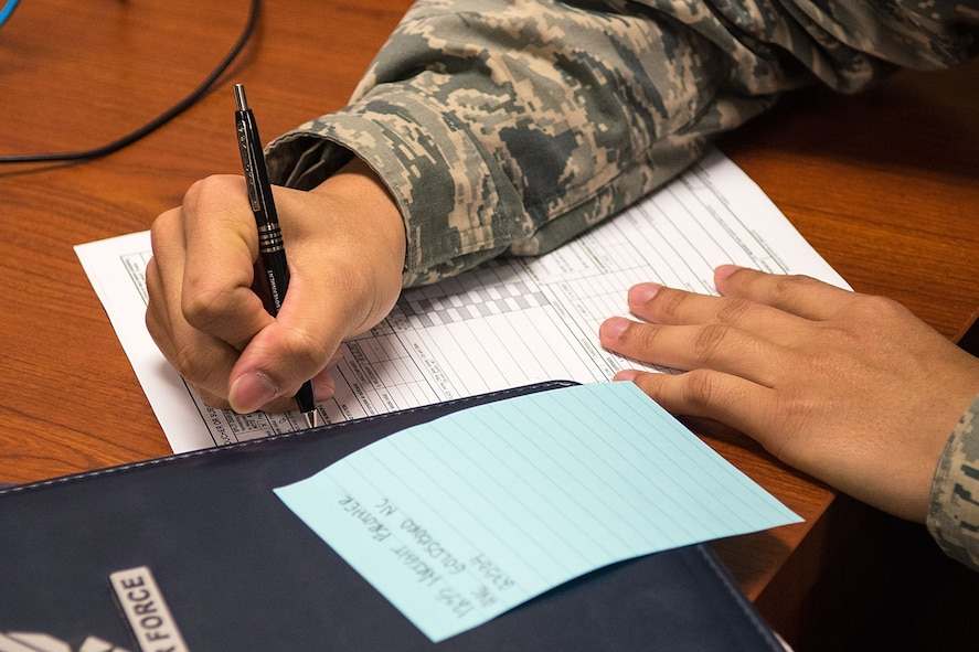 Airman 1st Class Tin Diep, 4th Aircraft Maintenance Squadron avionics technician, fills out a finance form, Jan. 17, 2018, at Seymour Johnson Air Force Base, North Carolina.