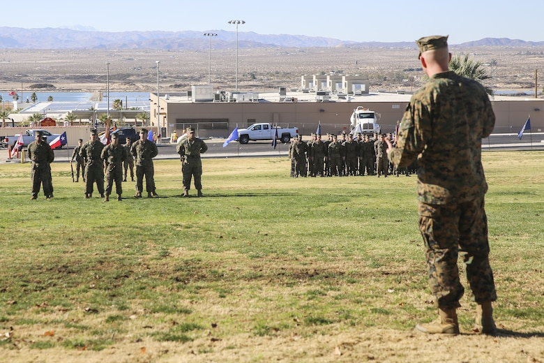 Sgt. Maj. Brian E. Anderson, incoming sergeant major, 1st Battalion, 7th Marine Regiment, Marine Corps Air Ground Combat Center Twentynine Palms, Calif., provides some encouraging words to his new Marines during the post and relief ceremony at the commanding general's lawn aboard the Combat Center Jan. 11, 2018. During the ceremony Cedeno relinquished his post as sergeant major to Sgt. Maj. Brian E. Anderson, incoming sergeant major, 1/7, MCGACC. (Official Marine Corps photo by Lance Cpl. Margaret Gale)