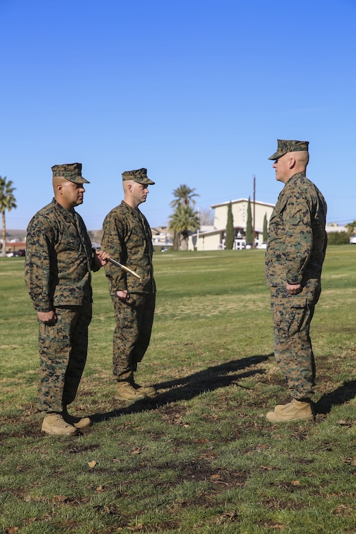 Sgt. Maj. Michael E. Cedeno, off going sergeant major, 1st Battalion, 7th Marine Regiment, Marine Corps Air Ground Combat Center Twentynine Palms, Calif.,  prepares to hand over the Mameluke sword as he relinquishes his post at the commanding general's lawn aboard the Combat Center Jan. 11, 2018.  During the ceremony Cedeno relinquished his post as sergeant major to Sgt. Maj. Brian E. Anderson, incoming sergeant major, 1/7, MCGACC. (Official Marine Corps photo by Lance Cpl. Margaret Gale)