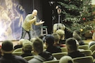 Benari Poulten, a comic with the GIs of Comedy and a master sergeant with the U.S. Army Reserve, tells a joke to Soldiers of 5th Squadron, 4th Cavalry Regiment, 2nd Armored Brigade Combat Team, 1st Infantry Division, in Swietoszow, Poland, Dec. 22.