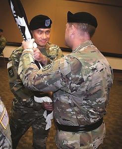 Col. John Melton, left, Irwin Army Community Hospital commander, returns the hospital colors to Maj. Gen. Thomas R. Tempel Jr., commanding general, Regional Health Command – Central, Dec. 15 to symbolize the relinquishment of his command. Melton has been the IACH commander since June 2016 and will become the commander of Womack Army Medical Center at Fort Bragg, North Carolina.