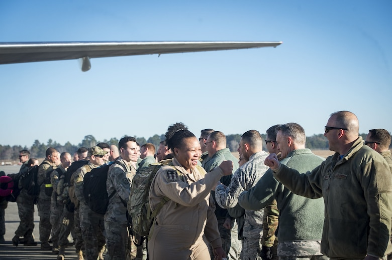 Airmen from the 74th Fighter Squadron (FS) greet base leadership during a redeployment ceremony, Jan. 19, 2018, at Moody Air Force Base, Ga. The 74th FS conducted around-the-clock planning and operations, which have decimated ISIS' fighting capacity with precise strikes, erasing tens of thousands of fighters from ISIS rosters.