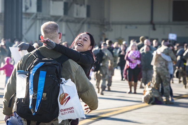 Rachel Hinton, embraces her husband, Staff Sgt. Eric Hinton, 723d Aircraft Maintenance Squadron, during a redeployment ceremony, Jan. 19, 2018, at Moody Air Force Base, Ga. While deployed in support of Operation Inherent Resolve, the 74th FS earned 65 Air Medals, five single-event Air Medals, four Combat Action Medals, and received four Distinguished Flying Cross nominations. (U.S. Air Force photo by Staff Sgt. Ceaira Young)