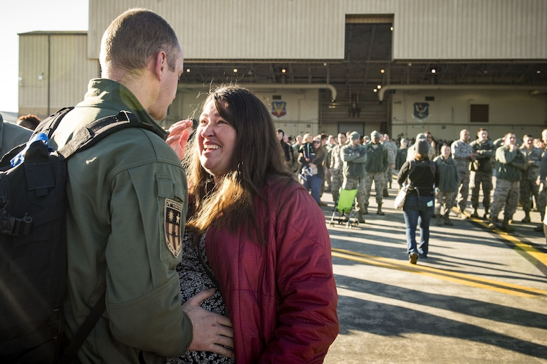 """Maj. Matthew """"Chowder"""" Cichowski, 74th Expeditionary Fighter Squadron (EFS) A-10C Thunderbolt II pilot, greets his wife, Sara during a redeployment ceremony, Jan. 19, 2018, at Moody Air Force Base, Ga. During the seven-month deployment, the 74th FS flew more than 1,700 sorties, employed weapons over 4,400 times, destroyed 2,300 targets and killed 2,800 ISIS insurgents. (U.S. Air Force photo by Staff Sgt. Ceaira Young)"""