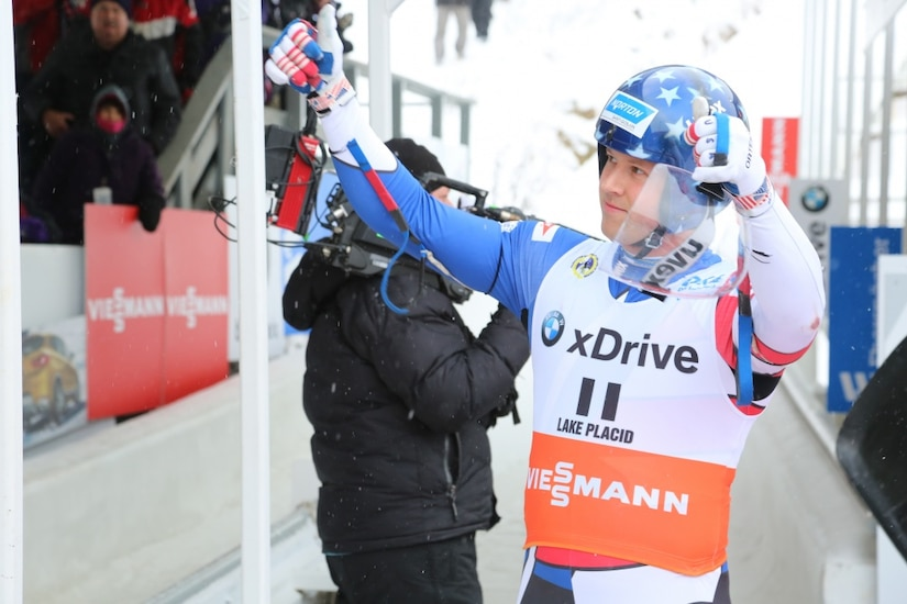 Luge team member acknowledges crowd at 2017 World Cup competition.