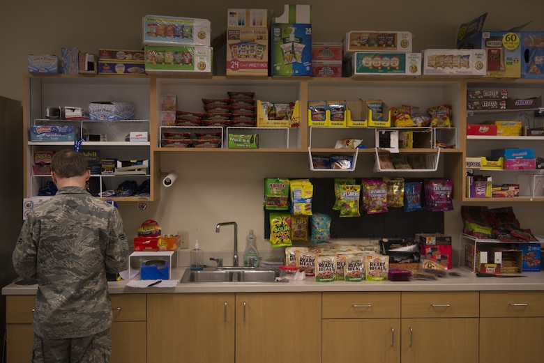 A 62nd Aircraft Maintenance Unit member prepares his lunch in front of the AMU snackbar Jan. 18, 2018, at Luke Air Force Base. Deb Robinson, the base dietician, is leading an initiative to change snackbars to offer healtheir options in an effort to improve the fitness and physical efficiency of Luke's Airmen. (U.S. Air Force photo/Senior Airman Ridge Shan)