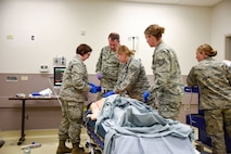 114th Medical Group Airmen work on a high-technology mannequin with simulated cardiac arrest at Tripler Medical Simulation Center, Jan. 12, 2018, Honolulu, HI.