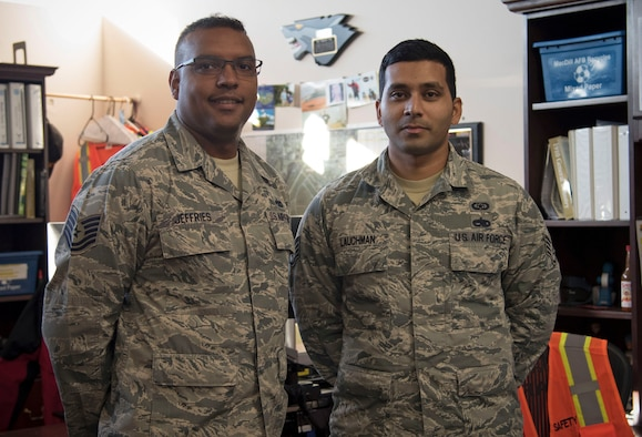 U.S. Air Force Tech. Sgt. Robert Jeffries, the NCO in charge of Flight Safety, and Staff Sgt. Mohindra Lauchman, an occupational safety journeyman, with the 6th Air Mobility Wing, pause for a photo at MacDill Air Force Base, Fla., Jan. 18, 2018. During the holiday season, through the help of Jeffries and leadership, Lauchman was able to take emergency leave to visit his grandfather in New York. (U.S. Air Force photo by Airman 1st Class Ashley Perdue)