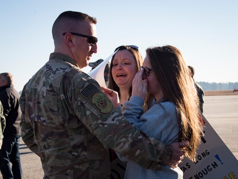 A family shares a moment during a redeployment ceremony for the 74th Fighter Squadron, Jan. 19, 2018, at Moody Air Force Base, Ga. Over 300 Airmen from Team Moody deployed for seven months in support of Operation Inherent Resolve to defeat ISIS in designated areas in Iraq and Syria. (U.S. Air Force photo by Andrea Jenkins)