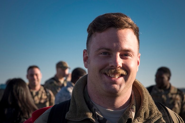 Staff Sgt. Kent Finnen, 74th Aircraft Maintenance Unit weapons team chief, poses for photo during a redeployment ceremony, Jan. 19, 2018, at Moody Air Force Base, Ga. The 74th Fighter Squadron conducted around-the-clock planning and operations, which have decimated ISIS' fighting capacity with precise strikes, erasing tens of thousands of fighters from ISIS rosters. (U.S. Air Force photo by Andrea Jenkins)