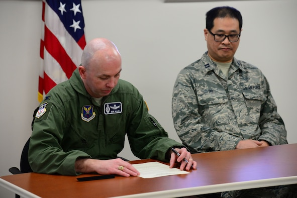 Col. Ronald Allen, 341st Missile Wing commander, left, signs a proclamation for Biomedical Sciences Corps Appreciation Week Jan. 19, 2018, at Malmstrom Air Force Base, Mont.