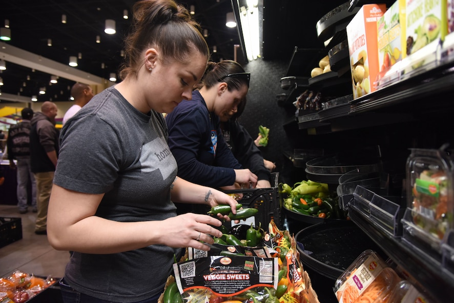 Tech. Sgt. Brittany Tyo, Mathies NCO Academy student, packages food items during a food drive at the Mississippi Coast Coliseum and Convention Center Jan. 16, 2018, Biloxi, Mississippi. More than 80 Airmen participated in the wing-level community sponsored volunteer event packaging over 21,000 pounds of food, equating to approximately 17,500 meals that will be provided to hunger relief. (U.S. Air Force photo by Kemberly Groue)