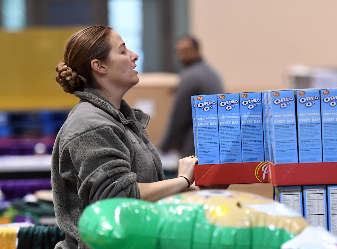 Tech. Sgt. Jennifer Watts, 81st Training Wing command chief executive assistant, packages food items during a food drive at the Mississippi Coast Coliseum and Convention Center Jan. 16, 2018, Biloxi, Mississippi. More than 80 Airmen participated in the wing-level community sponsored volunteer event packaging over 21,000 pounds of food, equating to approximately 17,500 meals that will be provided to hunger relief. (U.S. Air Force photo by Kemberly Groue)