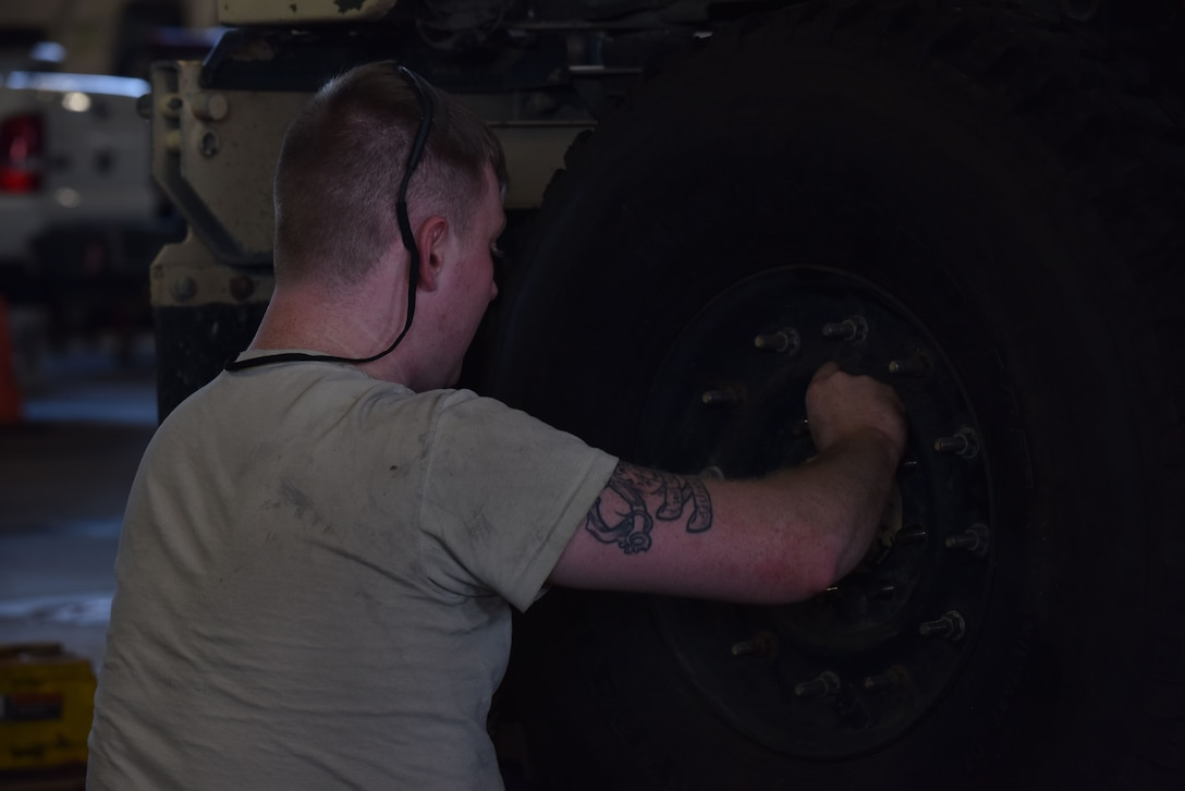 Members of the 509th Logistics Readiness Squadron (LRS) vehicle maintenance shop, perform various mechanical