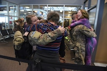 Senior Airman Pamela Fehr, left, and Staff Sgt. Michael Blake, both of the 119th Security Forces Squadron, North Dakota Air National Guard, return from deployment.