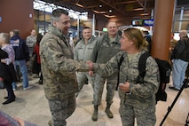 Col. Britt Hatley, the 119th Wing commander, North Dakota Air National Guard, welcomes Airmen home from deployment.