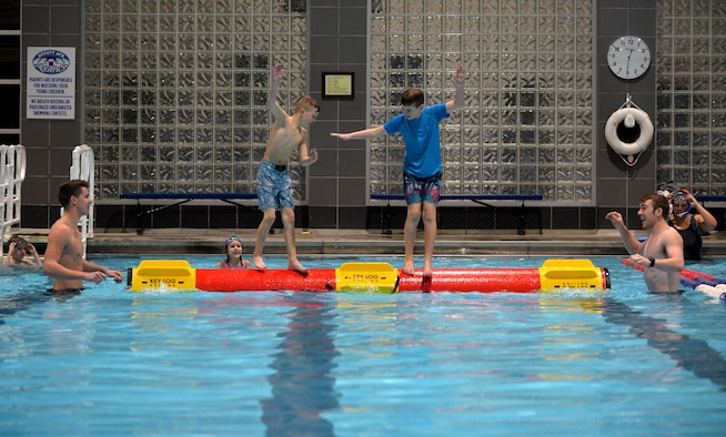 Luke Iverson and his brother Lane, sons of Master Sgt. Mike Iverson, 55th Security Forces Squadron flight chief, compete with one another to be the last sibling standing on the Key Log at the base lap-pool located in the Offutt Field House on Jan. 13, 2018.
