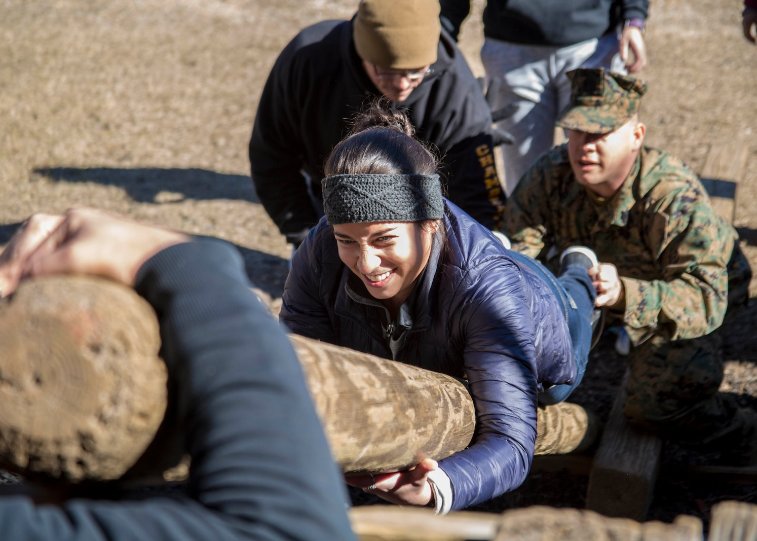 Samantha Mercurio, a teacher from Springstead High School, participates in the Leadership Reaction Course during the Educators Workshop aboard Marine Corps Recruit Depot Parris Island, South Carolina, Jan. 18, 2017.  These educators traveled from Recruiting Station (RS) Fort Lauderdale and RS Tampa to experience the Educators Workshop. The workshop allows educators to have an inside look at educational benefits and career opportunities in the Marine Corps to better inform their students. (U.S. Marine Corps photo by Lance Cpl. Jack A. E. Rigsby)