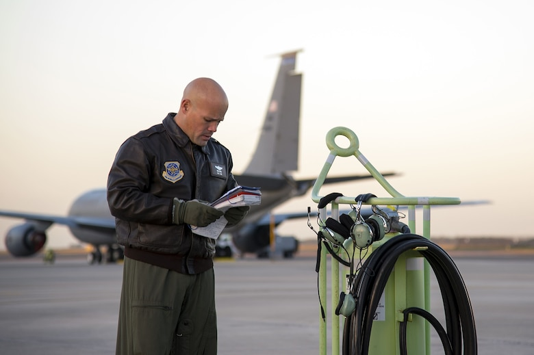 U.S. Air Force Lt. Col. Ricardo Lopez, the 50th Air Refueling Squadron (ARS) commander, reviews the exterior inspection checklist before taking off for the first 50th ARS training mission at MacDill Air Force Base, Fla., Jan. 16, 2018. This training mission came three months after the 50th ARS was relocated from Little Rock Air Force Base, Arkansas, bringing one of the most decorated flying units back to Tampa.