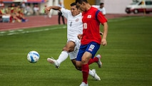 MUNGYEONG, South Korea, (Sept. 30, 2015)— Aaron Zendejas of the U.S. Mens Soccer Team fights for the ball at the first soccer match of the 2015 6th CISM World Games. The CISM World Games provides the opportunity for the athletes of over 100 different Nations to come together and enjoy friendship through sports. The sixth annual CISM World Games are being held aboard Mungyeong, South Korea, Sept. 30-Oct. 11.