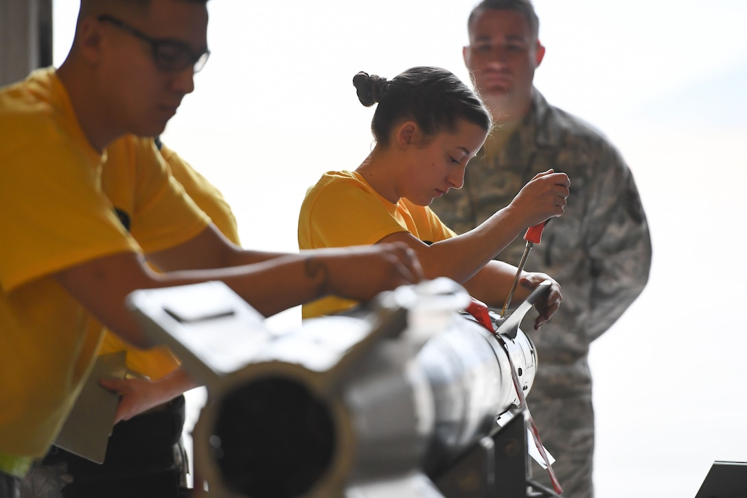 Staff Sgt. Kayla Bruns from the 4th Aircraft Maintenance Unit in the 388th Fighter Wing preps a GBU-12 laser guided bomb during the F-35A weapons loading competition Jan. 19, 2018, at Hill Air Force Base, Utah. These competitions benefit Airmen by honing their specialty skills and bolsters comradery and friendly rivalries. (U.S. Air Force photo by Cynthia Griggs)