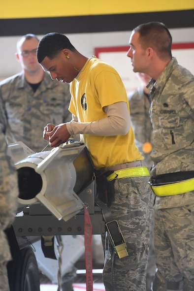 Senior Airman Deshone Davie from the 4th Aircraft Maintenance Unit in the 388th Fighter Wing preps a GBU-12 laser guided bomb during the F-35A weapons loading competition Jan. 19, 2018, at Hill Air Force Base, Utah. These competitions benefit Airmen by honing their specialty skills and bolsters comradery and friendly rivalries. (U.S. Air Force photo by Cynthia Griggs)