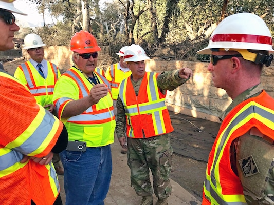 Tom Fayram, deputy public works director for Santa Barbara County, briefs Lt. Gen. Todd Semonite (center), commanding general of the U.S. Army Corps of Engineers, at the Montecito debris basin in Montecito, California, Jan. 18 during a visit to the site of a deadly mudslide. The Corps, as assigned by the Federal Emergency Management Agency, is removing more than 450,000 cubic yards of debris from 11 basins and 10 channels in areas of Santa Barbara, California, hit hard by the disaster that left 18 people dead.