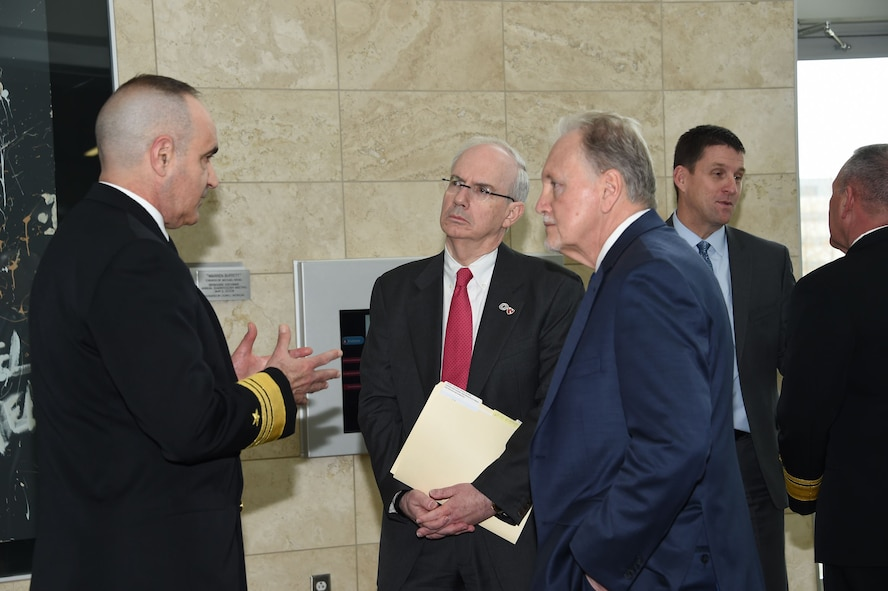 U.S. Navy Vice Adm. Charles Richard (left), deputy commander of U.S. Strategic Command (USSTRATCOM), speaks to Dr. Jeffrey Gold (center), University of Nebraska at Omaha (UNO) chancellor, and Dr. Lou Pol, dean of UNO's College of Business, during the USSTRATCOM Leadership Fellows Program kickoff at the UNO's Mammel Hall, Jan. 18, 2018.