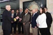 U.S. Navy Vice Adm. Charles Richard (left), deputy commander of U.S. Strategic Command (USSTRATCOM), speaks with fellows program participants during the 2018 USSTRATCOM Strategic Leadership Fellows Program kickoff at University of Nebraska at Omaha's Mammel Hall, Jan. 18, 2018.