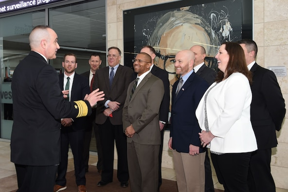 U.S. Navy Vice Adm. Charles Richard (left), deputy commander of U.S. Strategic Command (USSTRATCOM), speaks with fellows program participants during the 2018 USSTRATCOM Strategic Leadership Fellows Program kickoff at University of Nebraska at Omaha's Mammel Hall, Jan. 18, 2018.