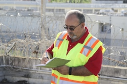 Alfredo Rodriguez, a U.S. Army Corps of Engineers civil engineer from the Walla Walla District's Hydrology and Hydraulics Branch, assesses hurricane-damaged critical public facilities Dec. 4, 2017, in Puerto Rico.