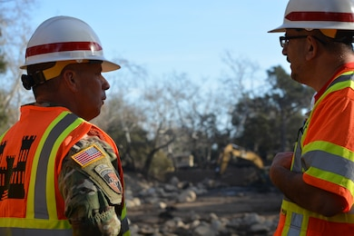 U.S. Army Corps of Engineers Commanding General Lt. Gen. Todd Semonite speaks with Los Angeles District Project Engineer Robert Ramos about debris removal activities at a detention basin in Montecito, California, Jan. 18. The Corps, as assigned by the Federal Emergency Management Agency, is removing more than 450,000 cubic yards of debris from 11 basins and 10 channels in areas of Santa Barbara, California, hit hard by the disaster that left 18 people dead.