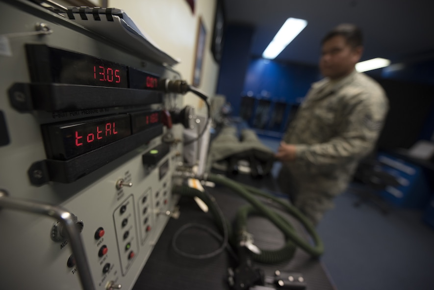 U.S. Air Force Staff Sgt. Shaun Kileleman, 44th Fighter Squadron aircrew flight equipment assistant NCO in charge, uses a combined aircrew system tester to check an anti-gravity suit Jan. 18, 2018, at Kadena Air Base, Japan. The anti-gravity suit enables pilots to endure accelerated forces by keeping blood flow from their lower extremities while experiencing large amounts of gravitational force. (U.S. Air Force photo by Staff Sgt. Micaiah Anthony)