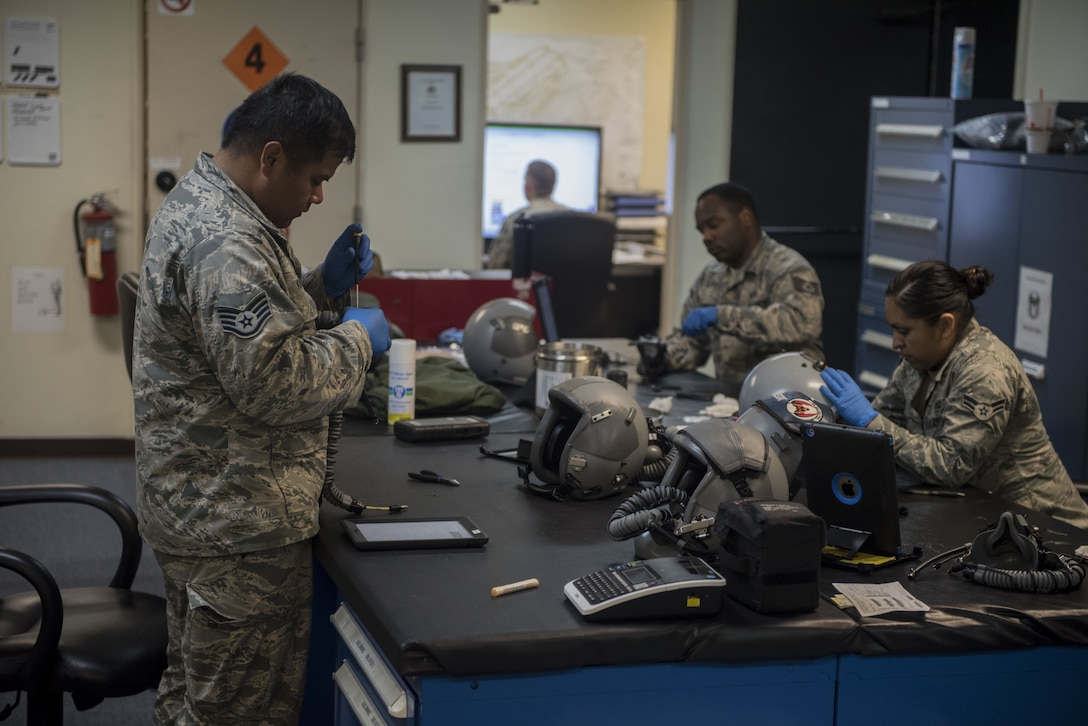 U.S. Air Force Airmen from the 44th Fighter Squadron aircrew flight equipment shop clean and inspect aircrew flight equipment Jan. 18, 2018, at Kadena Air Base, Japan. AFE Airmen maintain helmets, joint helmeted mounted cueing systems, harness', survival vests, advanced technology anti-gravity systems, gravity suits, night vision goggles and chemical gear. (U.S. Air Force photo by Staff Sgt. Micaiah Anthony)