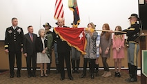 Brig. Gen. Richard R. Coffman, 1st Infantry Division deputy commanding general for maneuver, and his wife, Jacqui, unfurl the brigadier general officer flag during his promotion ceremony Jan. 5 at the division headquarters on Fort Riley. Joining Coffman for the unfurling was Maj. Gen. Joseph M. Martin, far left, 1st Inf. Div. and Fort Riley commanding general, and family members.