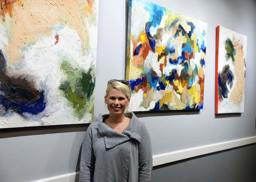 Emmie Sherertz, local artist, stands next to her work Jan. 12, 2018, inside of the Club on Columbus Air Force Base, Mississippi. The Club art gallery was created in 2015 with the opening of the newly renovated Club. The Columbus Arts Council switches the art out roughly every two months, providing six artists a year to showcase their work to the Columbus AFB service members and family. (U.S. Air Force photo by Airman 1st Class Keith Holcomb)