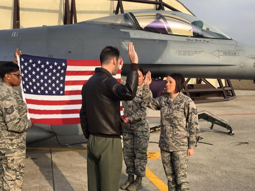 MSgt Ashley Strong (right), a U.S. Air Force dental flight chief, re-enlisted at Aviano Air Force Base, Italy on Feb 19th, 2016. It was here where she worked with her team, highlighting their strengths and learning from the experiences of her fellow Airmen to better provide quality patient care. (Courtesy photo)