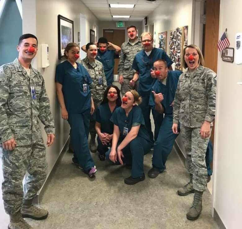 MSgt Ashley Strong (far right), U.S. Air Force dental flight chief out of Schriever Air Force Base, poses with her team for Red Nose Day to raise awareness about children in need on March 24th, 2017. Strong works closely with her team to instill a culture of patient-centered Trusted Care throughout the clinic. (U.S. Air Force photo by SrA Cody Helgeson)