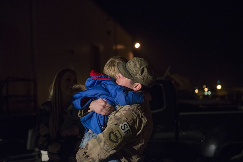 Staff Sgt. Issac McCauley, 436th Security Forces Squadron defender, hugs his son, Channing Hooser, after returning home from deployment to the Middle East Jan. 21, 2018, at Dover Air Force Base, Del. McCauley was welcomed home by his family after his six-month long deployment. (U.S. Air Force photo by Airman 1st Class Zoe M. Wockenfuss)