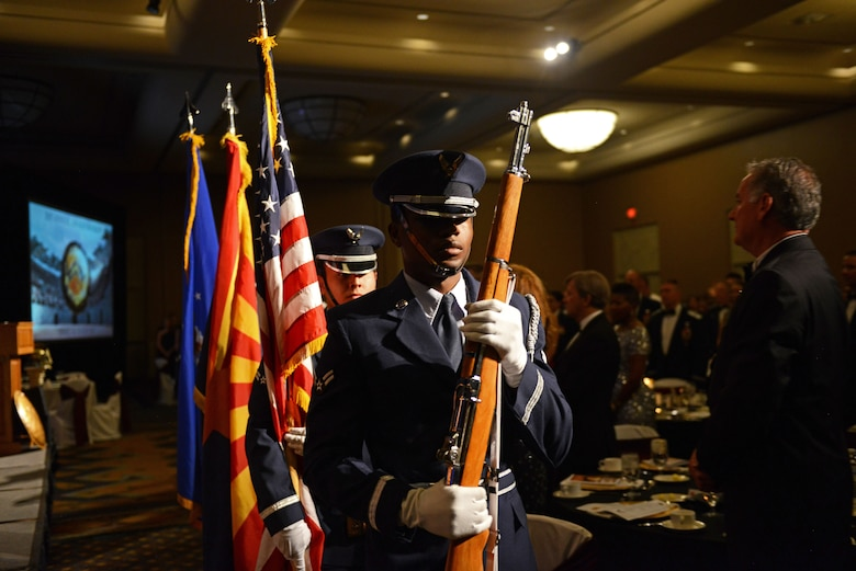 The Luke Air Force Base Color Guard present the colors at the 2017 Annual Awards Banquet in Litchfield Park, Ariz., Jan. 20, 2018. The 2017 Annual Awards Banquet was held to recognize and award the best and brightest Airmen from Luke. (U.S. Air Force Photo/Airman 1st Class Alexander Cook)