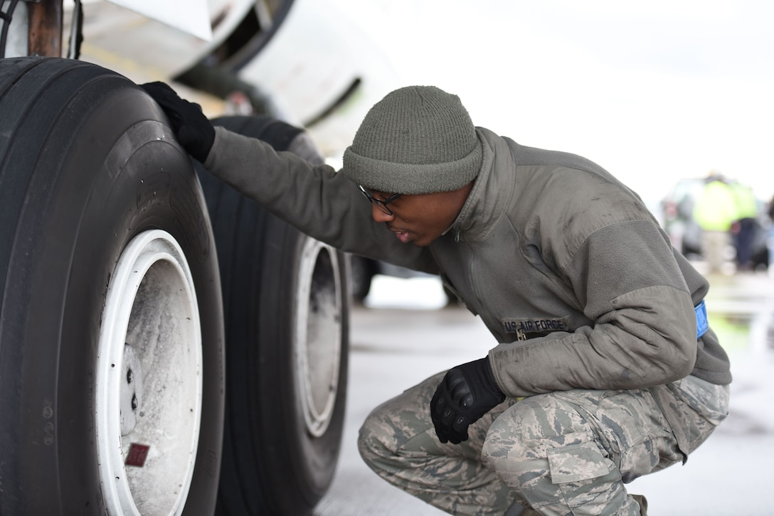 Senior Airman Christian Sharpe, 721st Air Maintenance Squadron crew chief, inspects the tire pressure on the United States National Aeronautics and Space Administration Armstrong Flight Research Center aircraft on Jan. 18, 2018 at Ramstein Air Base. According to a memorandum of agreement between the 721st AGOW and NASA, the 721st AGOW provided primary parking and towing services for the NASA research aircraft. (