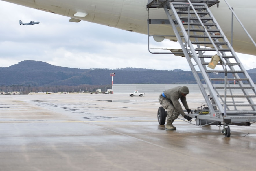 Senior Airman Christian Sharpe, 721st Air Maintenance Squadron crew chief, secures a mobile staircase to the United States National Aeronautics and Space Administration Armstrong Flight Research Center aircraft on Jan. 18, 2017 at Ramstein Air Base. According to NASA, continued investment and support will create future U.S. aircraft that consume only half as much fuel and generate only one quarter of current emissions compared to aircraft flown today.