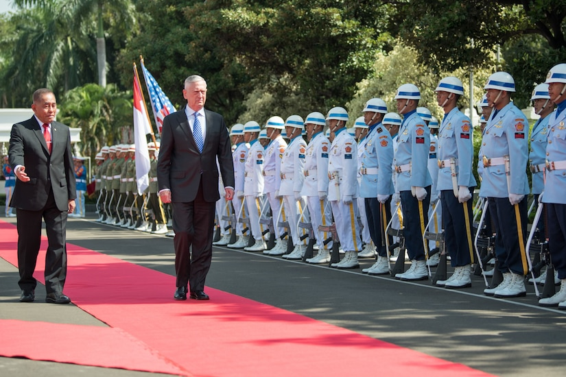 Defense Secretary James N. Mattis walks with the Indonesian defense minister during a pass and review.