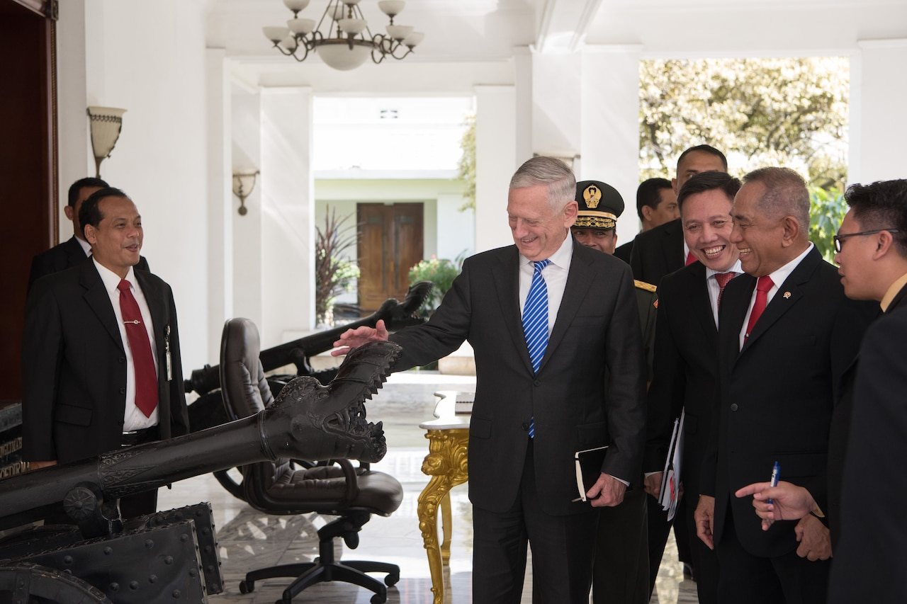 Defense Secretary Mattis examines an antique cannon at the Indonesian Defense Ministry.