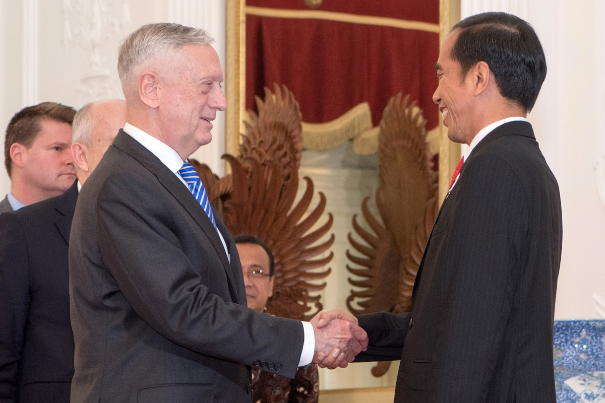 Defense Secretary James N. Mattis shakes hands with the Indonesian president.