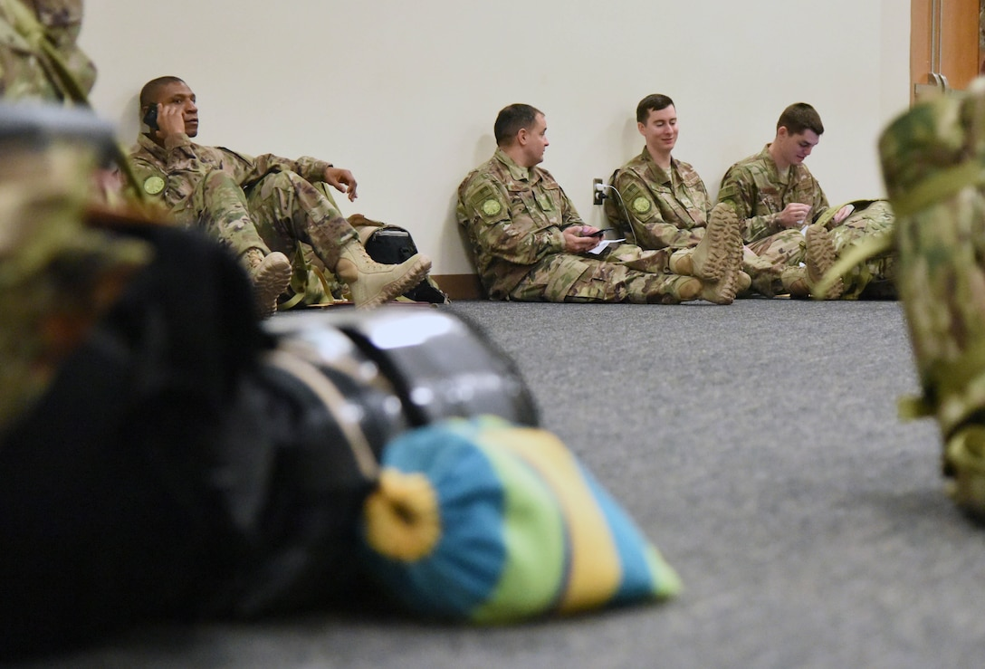 Keesler personnel rest while in-processing for deployment at the Roberts Consolidated Aircraft Maintenance Facility Jan. 8, 2018, on Keesler Air Force Base, Mississippi. Members of the 403rd Wing make preparations for an upcoming deployment to an undisclosed location. (U.S. Air Force photo by Kemberly Groue)