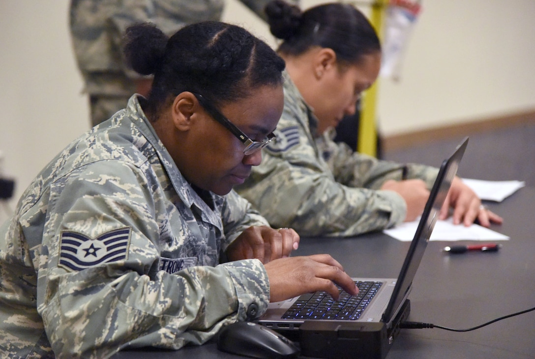 Tech. Sgt. Tomika Strong, 81st Logistics Readiness Squadron personal property passenger travel NCO in charge, in-processes Keesler personnel for deployment at the Roberts Consolidated Aircraft Maintenance Facility Jan. 8, 2018, on Keesler Air Force Base, Mississippi. Members of the 403rd Wing make preparations for an upcoming deployment to an undisclosed location. (U.S. Air Force photo by Kemberly Groue)