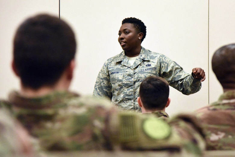Tech. Sgt. Sabrina Martin, 81st Logistics Readiness Squadron personal property passenger travel NCO in charge, briefs on anti- hijacking safety procedures to Keesler personnel as they in process for deployment at the Roberts Consolidated Aircraft Maintenance Facility Jan. 8, 2018, on Keesler Air Force Base, Mississippi. Members of the 403rd Wing make preparations for an upcoming deployment to an undisclosed location. (U.S. Air Force photo by Kemberly Groue)